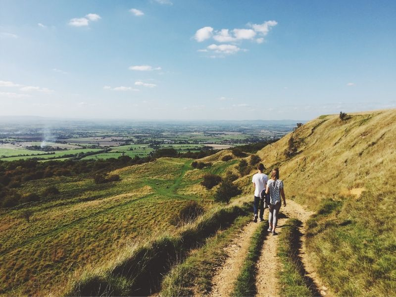 Couple walking through countryside